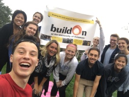 Some of those who attended the event with the buildOn banner.