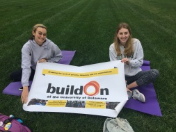 President, Julia Ross, and Trek Coordinator, Olivia Castillo, holding the buildOn banner to attract the public to the event.
